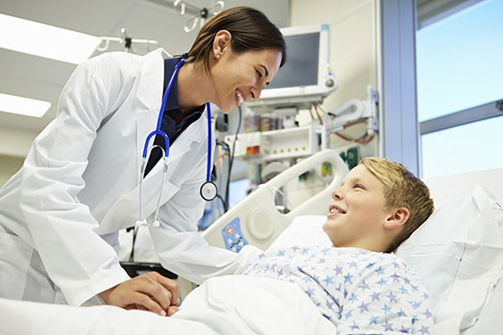 female doctor with young boy in hospital