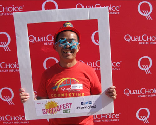 Employees holding QualChoice banner at Springfest